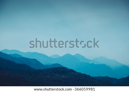 mountain landscape blue silhouette of peaks - stock photo