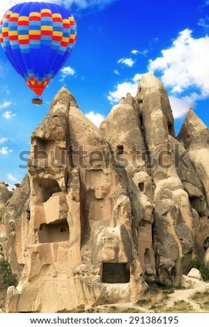 Mountain landscape, Hot air balloon flying stone valley Cappadocia Turkey - stock photo