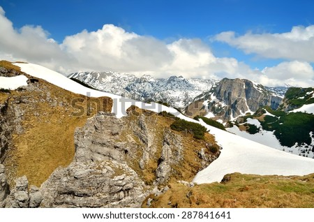 Mountain landscape in Austria. View from Loser peak over steep slope and summits covered with snow, Dead Mountains (Totes Gebirge), group of mountains in Austrian Alps. - stock photo