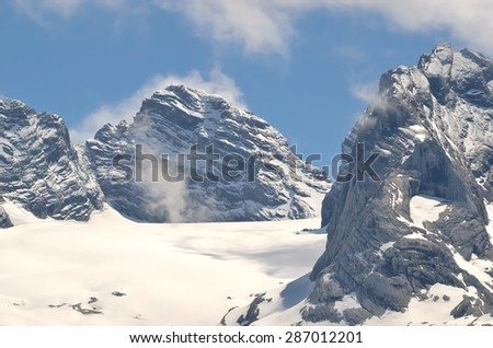 Mountain landscape in Austria. View of Hoher Dachstein from the lake Vorderer Gosausee in Austrian Alps. - stock photo