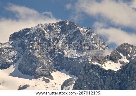 Mountain landscape in Austria. View of Mitterspitz from the lake Vorderer Gosausee in Austrian Alps. - stock photo