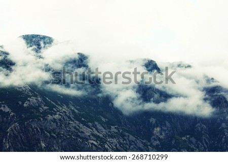 mountain landscape in Europe river gorge clouds