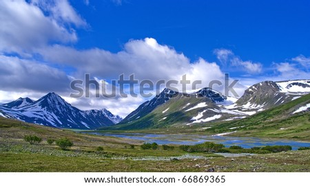 Mountain landscape in green valley with river - stock photo