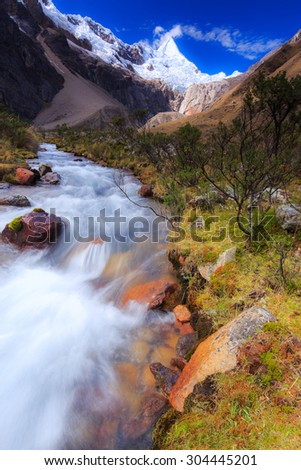 Mountain landscape in the Andes, Peru, Cordiliera Blanca, with Alpamayo peak in the background - stock photo