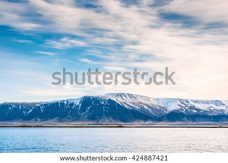 Mountain landscape in the ocean in Iceland - stock photo