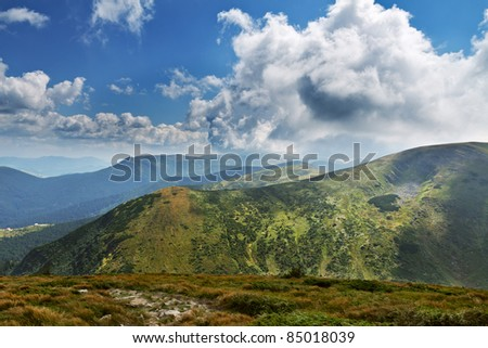 Mountain landscape. Sky. Clouds. Pine. - stock photo
