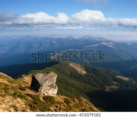 Mountain landscape with beautiful stone. Sunny weather summer day. Blue sky with cumulus clouds. Carpathians, Ukraine, Europe - stock photo