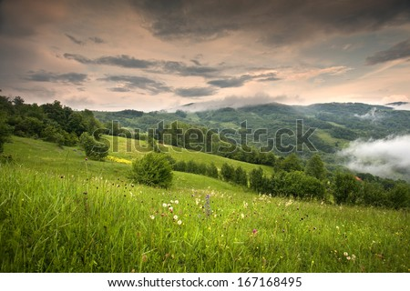 Mountain landscape with clouds before the rain - stock photo
