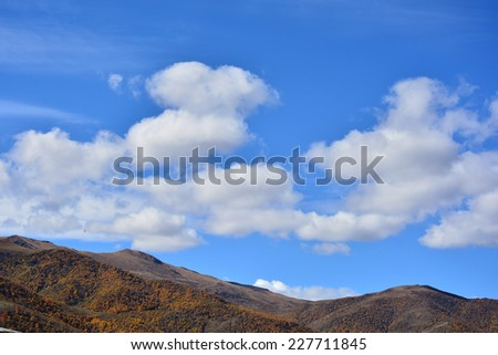 Mountain landscape with floating clouds - stock photo