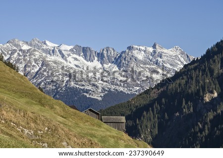 Mountain landscape with hay hut at Val Medel in Switzerland
