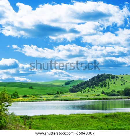 Mountain landscape with lake - stock photo