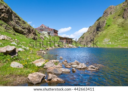 Mountain landscape with lake and mountain hut in Tyrol, Fieberbrunn, Austria - stock photo