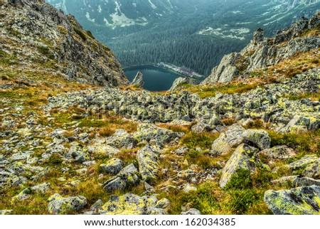 mountain landscape with mountain chalet near Poprad Pond, High Tatras, Slovakia - stock photo