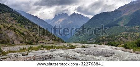 mountain landscape with mountain river Svaneti Georgia - stock photo