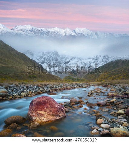 Mountain landscape with river and beautiful stones. Autumn evening in a beautiful place. Collage of two frames. Art processing photos