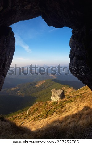 Mountain landscape with rocks. View from the cave. Beautiful World. Carpathians, Ukraine, Europe
