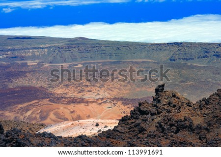 Mountain landscape with sky, clouds and volcanic rock. Teide, Tenerife, Canary Islands, Spain - stock photo