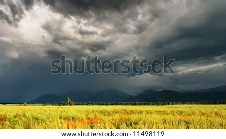 Mountain landscape with storm clouds - stock photo