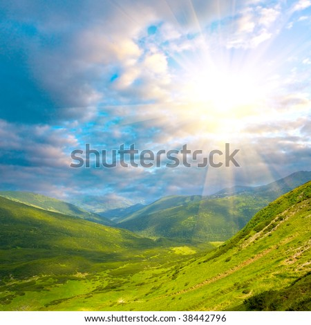 mountain landscape with sunshine in clouds - stock photo
