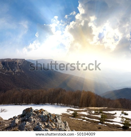 Mountain landscape with sunshine in valley