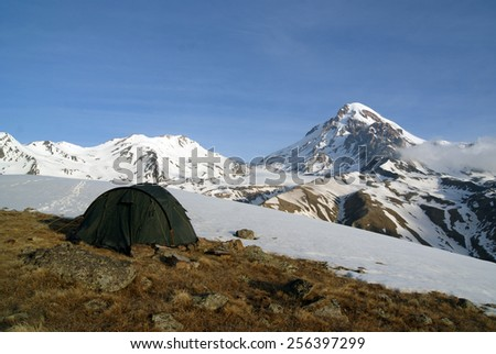 Mountain landscape with tent in the foreground - stock photo