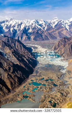 Mountain Landscape with Unique Moraine Glacier Lakes and Icefall with Rock and Snow Slopes and Summits on Horizon - stock photo