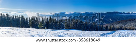mountain landscapes and panoramas of snow-capped mountain peaks in the winter ski resorts - stock photo