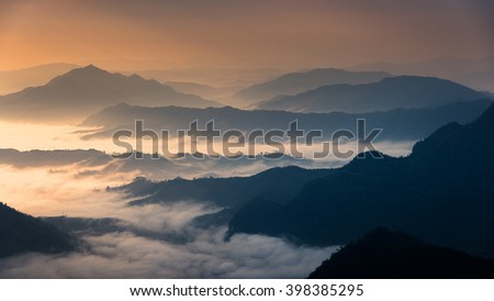 mountain layer with fog in the morning