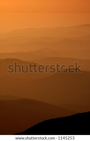 Mountain Layers in Silhouette - stock photo