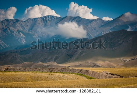 Mountain, light and cloud in Xinjiang - stock photo