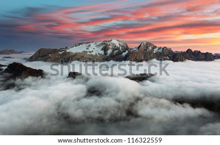 Mountain Marmolada at sunset in Italy dolomites at winter - stock photo