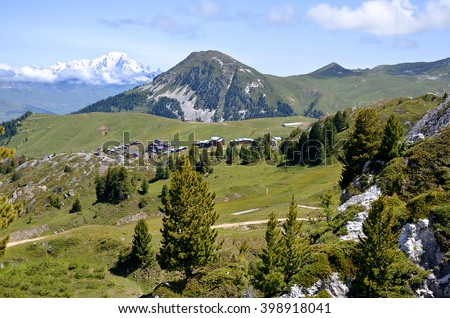 Mountain of La Plagne in the French Alps and snowy Mont Blanc massif in the background,commune in the Tarentaise Valley, Savoie department and Rhone-Alpes region, in France