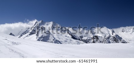 Mountain panorama. Caucasus, Dombay. View from the ski slope. - stock photo