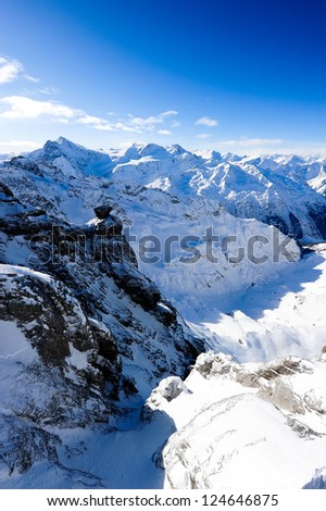 Mountain panorama from Titlis in winter over swiss alps, Engelberg, Switzerland - stock photo