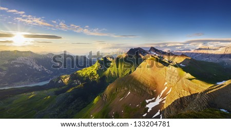 Mountain Panorama in the Swiss Alps at Sunset - stock photo