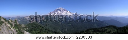 Mountain Panoramic with clear blue sky of Mount Rainier - stock photo