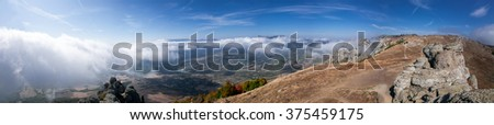 Mountain panorma at rock top. - stock photo