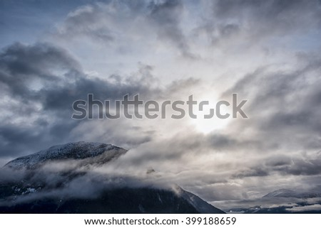Mountain peak covered in clouds - stock photo