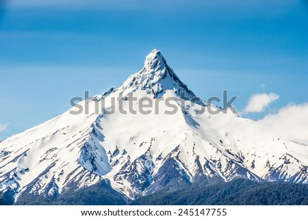 Mountain peak covered with snow in the Vicente Perez Rosales National Park, Sector Puella, Chile, South America - stock photo