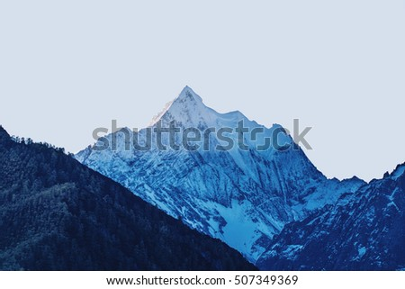 Mountain peak in pyramid shape and cooling color tone