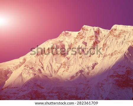 mountain peak in the Annapurna ridge at sunset, Himalayas - stock photo