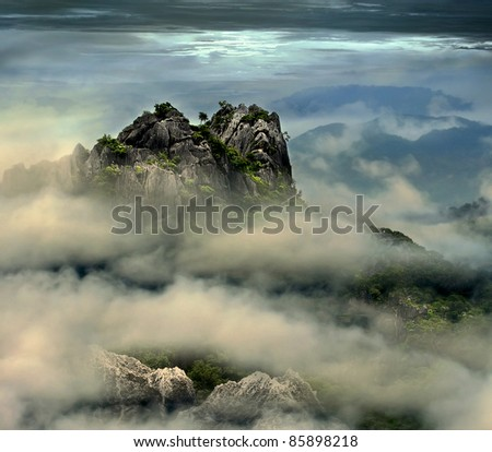 mountain peak in the mist (surreal retouching style)