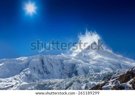 Mountain peak Manaslu in Himalayas - stock photo