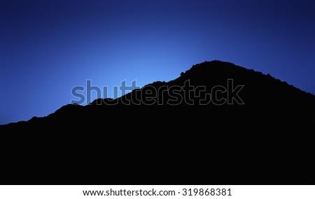 mountain peak silhouette - stock photo
