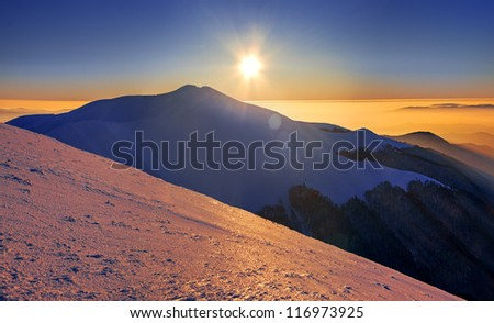 Mountain peak, sunset, winter landscape - stock photo