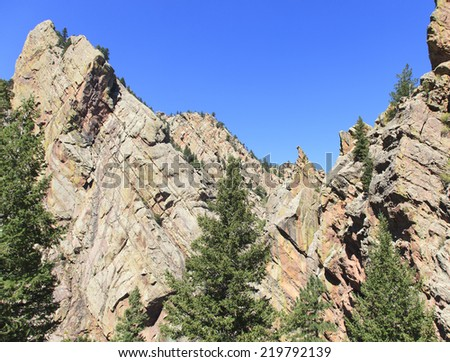 Mountain Peak surrounded by Pine Trees - stock photo