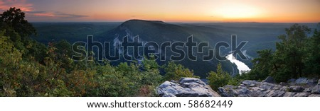 Mountain peak view panorama at dusk with river and trees from Delaware Water Gap, Pennsylvania. - stock photo