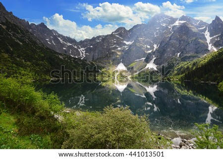 mountain peaks and blue sky - stock photo
