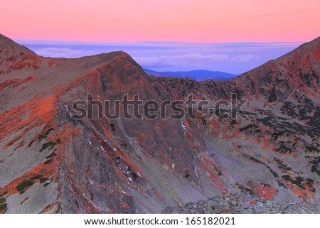 Mountain peaks and red sky at dawn - stock photo