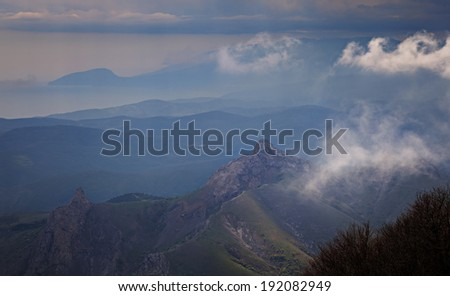 Mountain peaks in the clouds at dawn